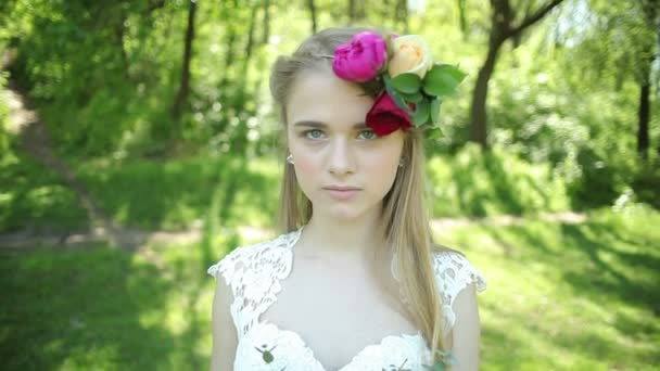 beautiful wedding bouquet of flowers in hands of young bride. weddings. young woman in the park, forest. wedding celebration. nature green background. Close up