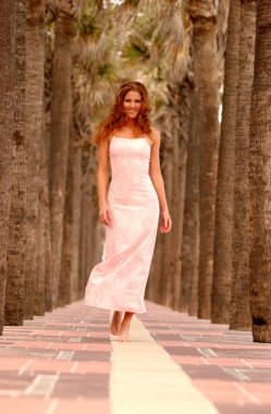 Red Head - Palm Tree Run-way Background - Pink Tight Dress
