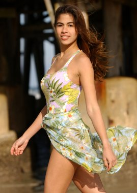 One Piece Flowered Swimsuit with Sarong - Brazilian Brunette Adorable Model - Beach Background