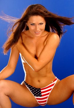 Red White and Blue American Flag Panties - Free Spirited Professional Model Implied topless playful sexy boudoir squatting sleek slim hour glass shape natural perky suggestive provocative beauty nude and naked free spirit goddess stunning kehoe