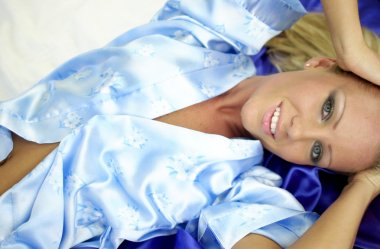 Light Blue Satin Robe - Dark Blue Satin Sheet - Sultry Sexy Bedroom Blonde