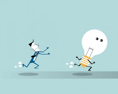 Businessman running  and trying to catch a big light bulb