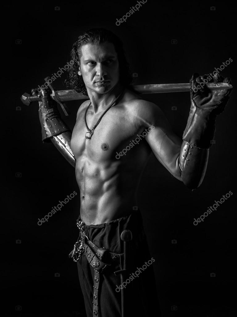 half naked man with a sword in medieval clothes — stock photo