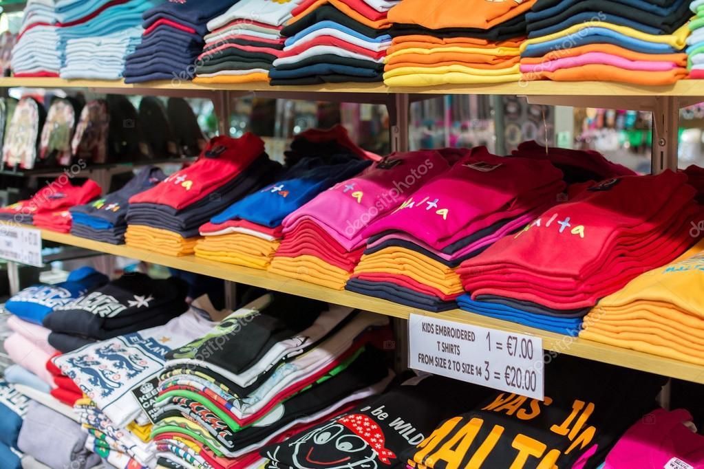 bright malta t shirts on shelves stock photo olleke 84022996 rh depositphotos com t shirt sleeves too wide t shirt sleeves too short