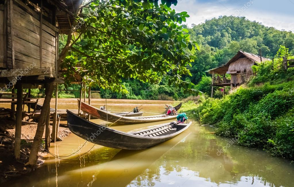 Long-tail boats in a village of stilt houses, Thailand