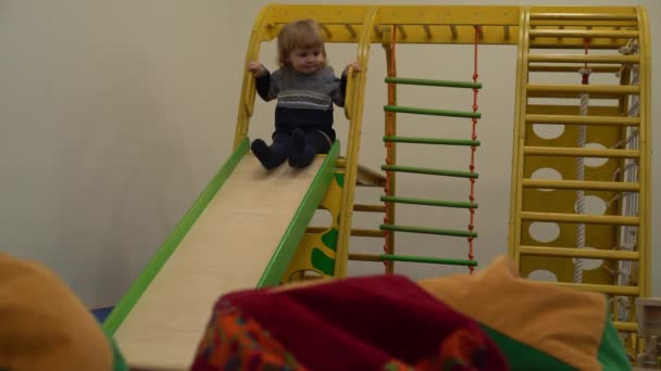 4K cute baby on the playground with slides down hill