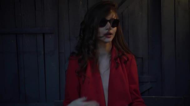 Glamorous sexy girl in sunglasses singing rap