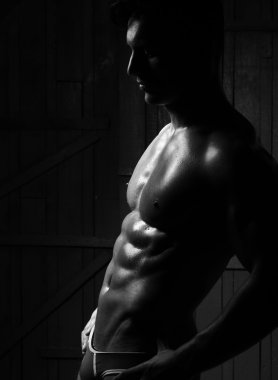 Silhouette of young muscular man
