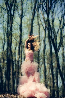 Pretty glamour woman in forest