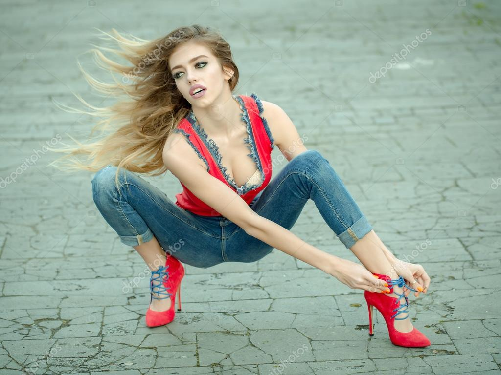 Beautiful and sexy girl sits in high heel shoes — Stock Photo ...