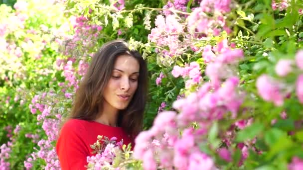 Sexy girl with flowers. Outdoor portrait of a beautiful woman.