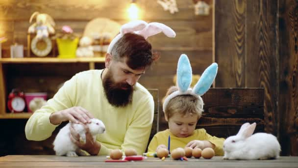 Easter Family holidays. Little bunny. Dad and child in bunny ears. Fatherhood concept.