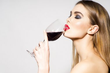 Glamour girl drinking wine