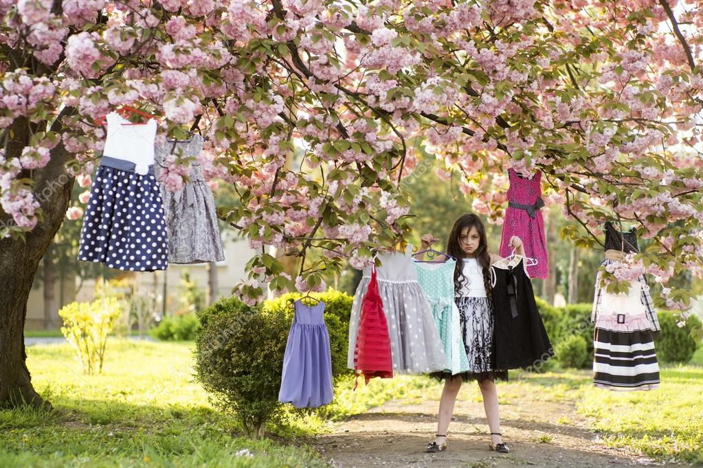 Little girl selecting clothes