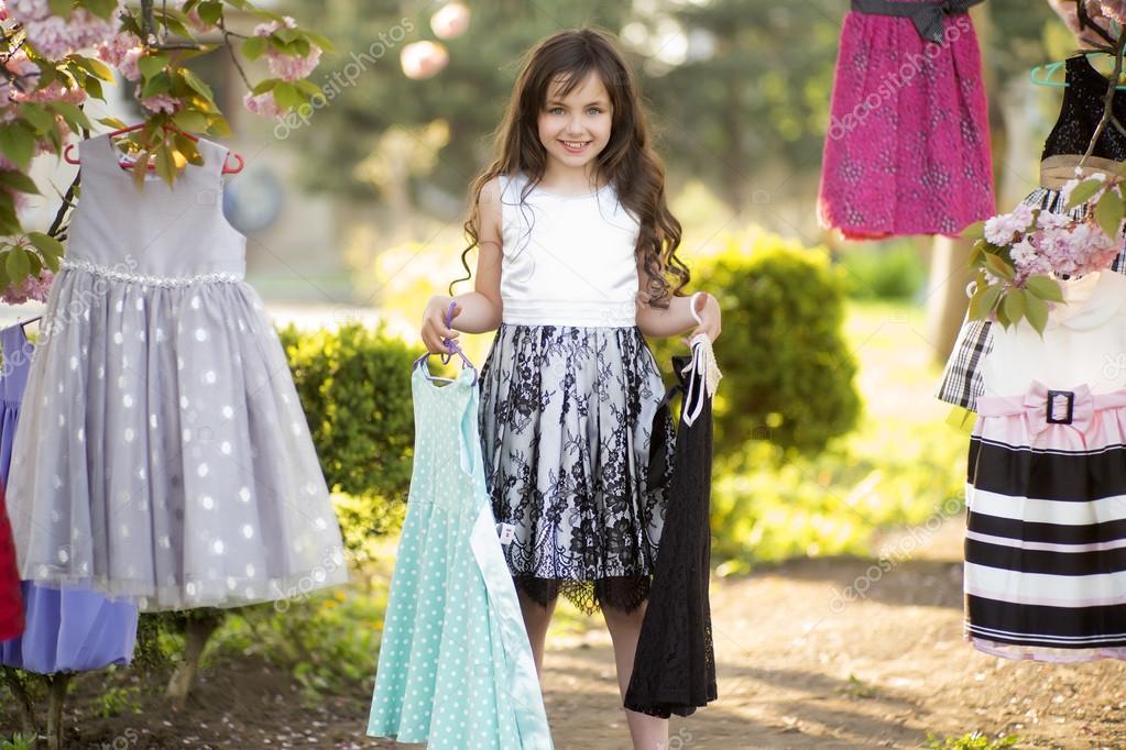 Little girl choosing clothes