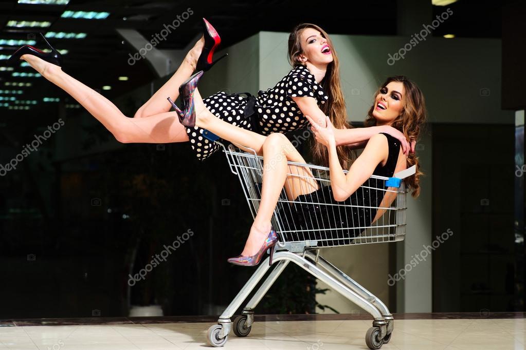 Two pretty girls in shopping trolley