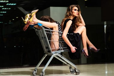 Misterious girls with shopping trolley
