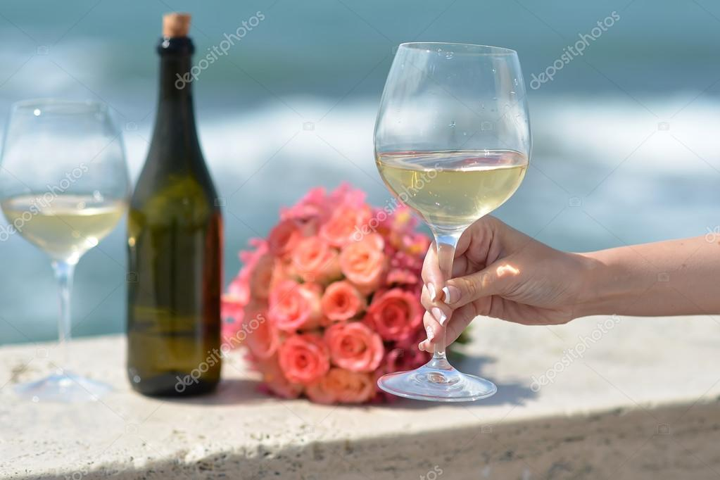 Wedding bouquet bottle and wine glasses