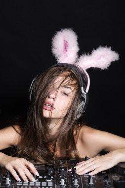 Sexy disk jockey girl with bunny ears