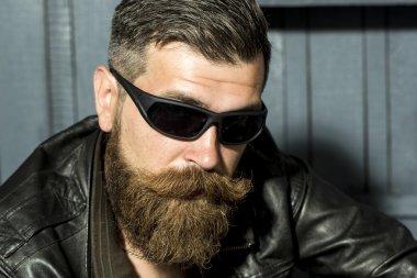 Portrait of handsome biker