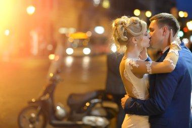 Wedding couple at night city street