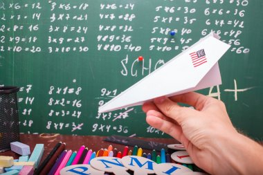 Paper plane at school lesson