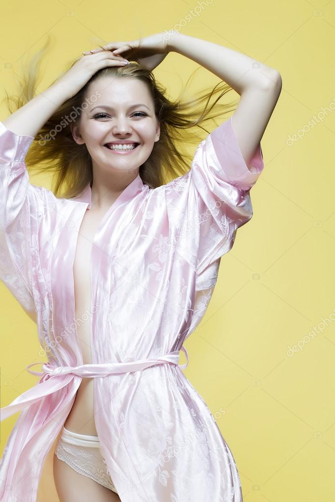 Lovely lady in dressing gown — Stock Photo © Tverdohlib.com #82189644