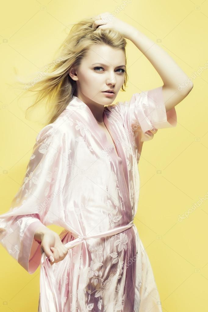 Blonde lady in dressing gown — Stock Photo © Tverdohlib.com #82439980