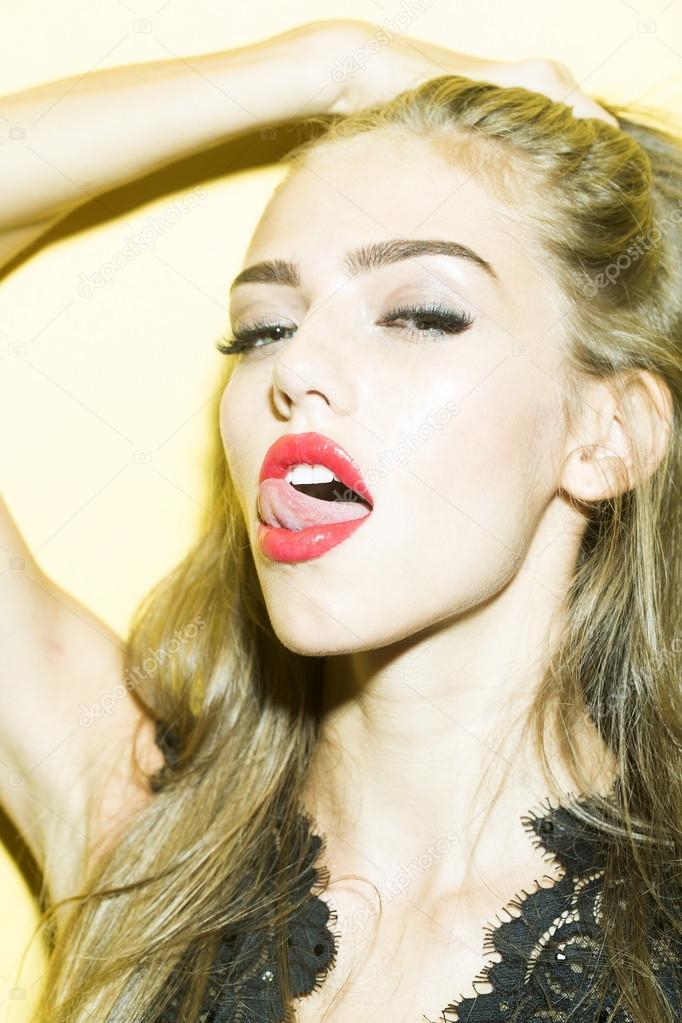 Sexy Woman Licking Lips Stock Photo