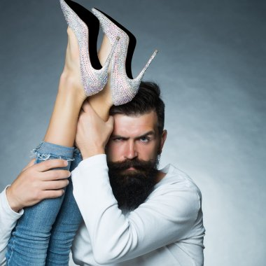 Man holding legs of woman