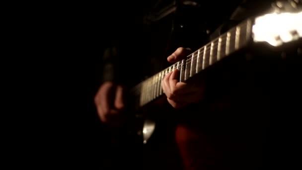 Man playing guitar solo