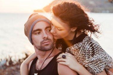couple hugs at sunshine near the seaside