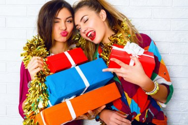sisters holding party gifts and presents