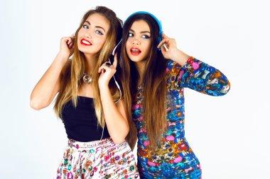two dj girls listening music