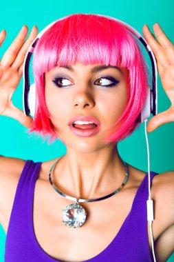 woman in pink wig and earphones