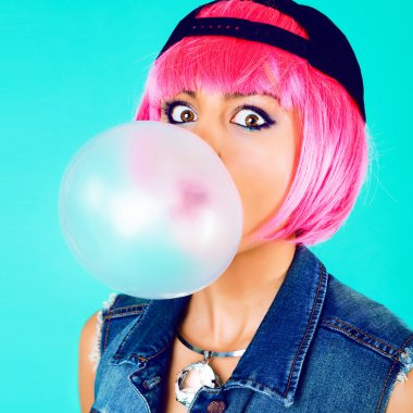 cheerful woman inflating the bubble gum