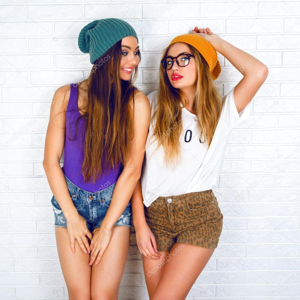 hipster girls posing at wall background stock photo. Black Bedroom Furniture Sets. Home Design Ideas