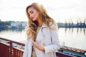 elegant lady posing neat sea port