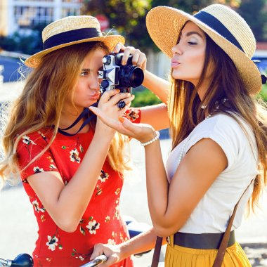 blonde taking picture of her friend