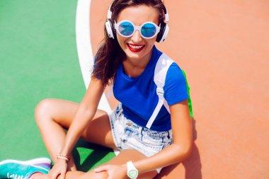 stylish woman posing at sport ground