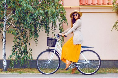 hipster girl with retro bike outdoors