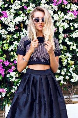 blonde woman wearing stylish outfit