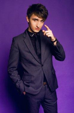 Handsome businessman wearing grey suit