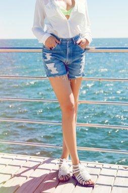 Woman posing at retro blue shorts