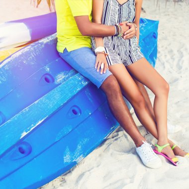 couple sitting at bright blue kayak boat