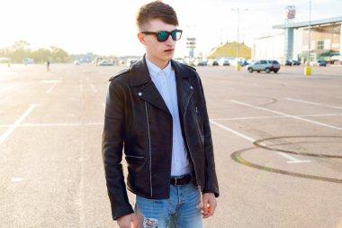 tylish man posing at countryside parking