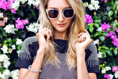 stunning blonde young woman in sunglasses
