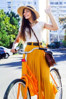 brunette girl riding her retro bicycle