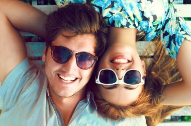 portrait of young perfect couple lying