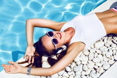 sexy dj girl laying near pool